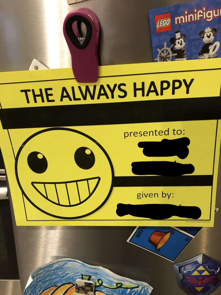 "photo of award certificate that reads ""the always happy"""