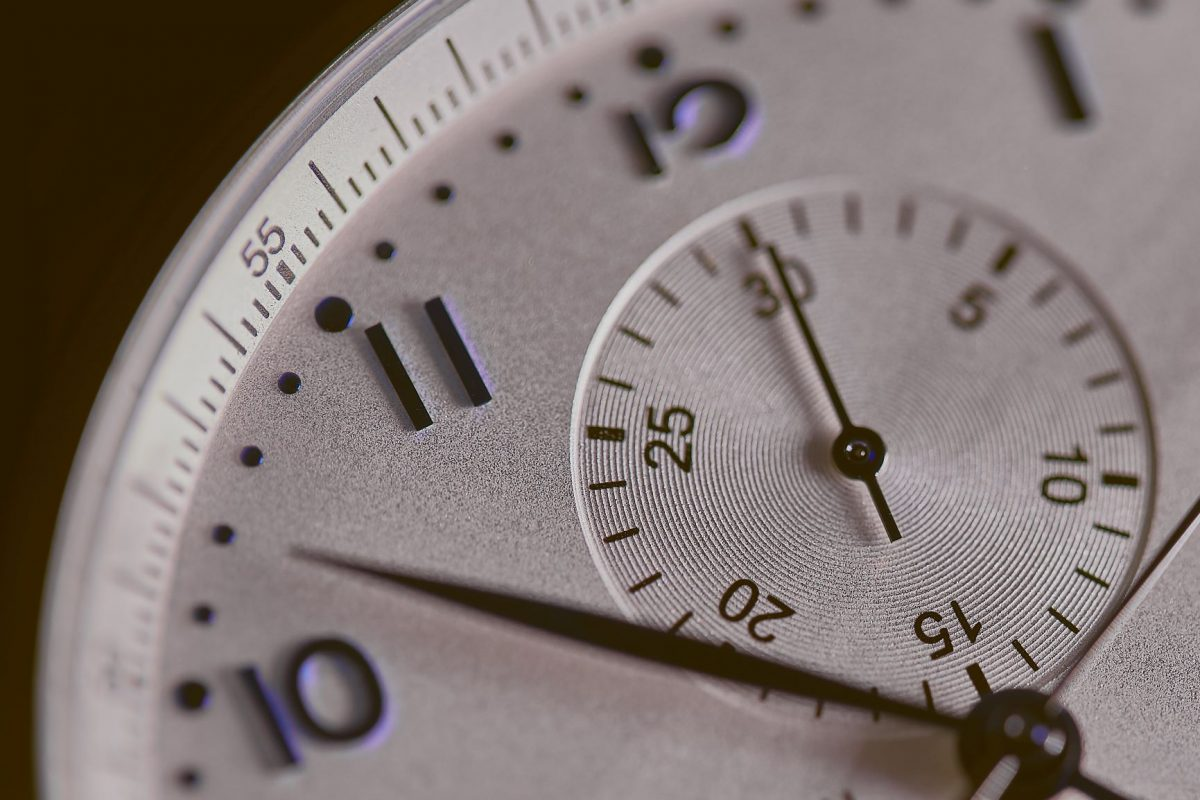 close up image of an analog clock